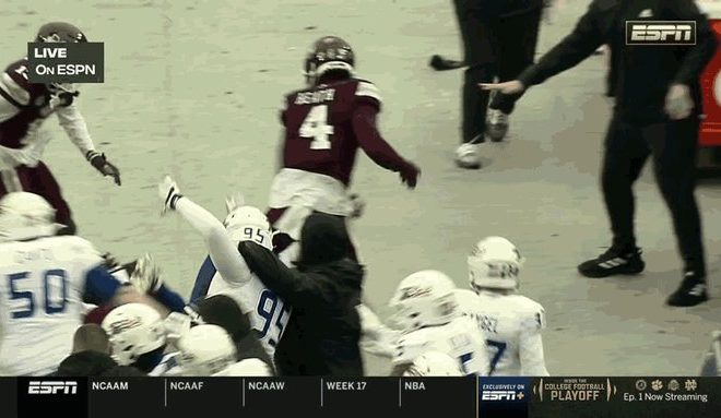 BRAWL ENSUES AT END OF ARMED FORCES BOWL